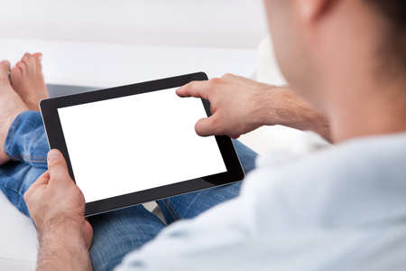 Close-up Of Man Holding Blank Digital Tablet photo