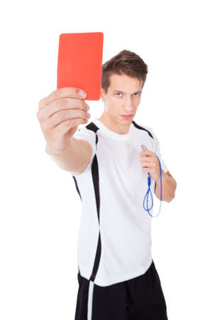 Young Soccer Referee Showing Red Card On White Background photo