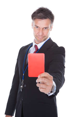 Portrait Of Mature Businessman Showing Red Card Over White Background photo