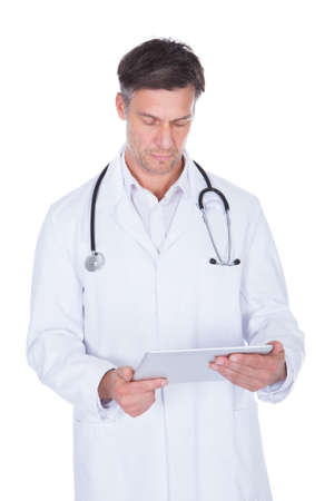 Portrait Of Happy Mature Male Doctor Holding Digital Tablet photo