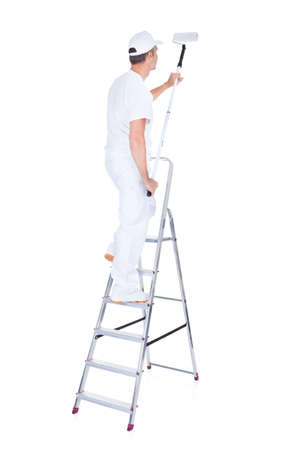 Mature Male Painter With Paint Roller And Ladder Over White Background