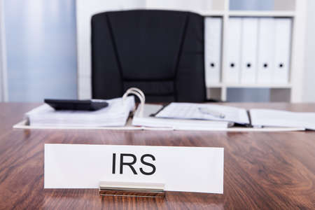 Office Desk And Chair With Irs Nameplate photo