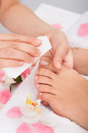 Close-up Of Beautician Hand Filing The Nails Of Woman In Salon Stock Photo - 25349711