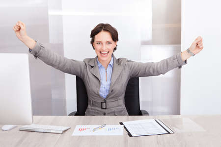 Successful Excited Young Businesswoman With Hand Extended photo