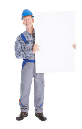 Happy Mature Architect Holding Placard On White Background photo