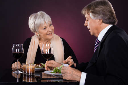couple dining: Happy Senior Couple Dining Together With Wine In A Restaurant Stock Photo