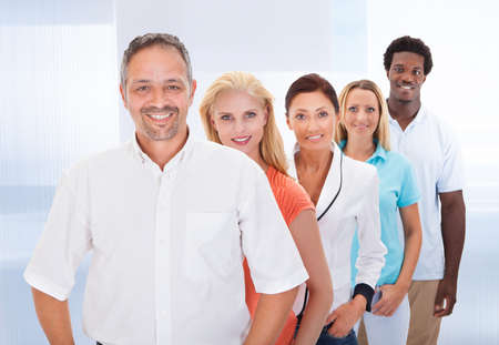people together: Group Of Happy Multi-racial People Standing In A Row