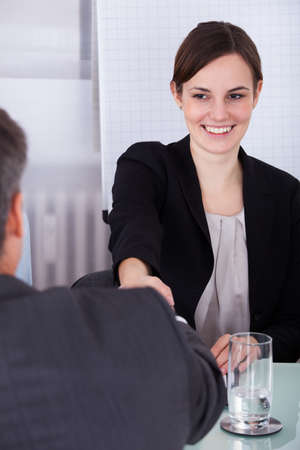 Portrait Of Happy Young Businesswoman Looking At Mature Businessman photo