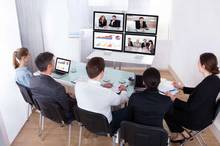 conference room meeting: High Angle View Of Businesspeople In Video Conference At Business Meeting