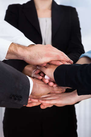 Close-up Of Group Of Business People With Hands Together Stock Photo