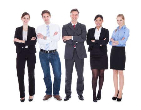 falda corta: Grupo de gente de negocios feliz de pie en pose Sobre Fondo Blanco