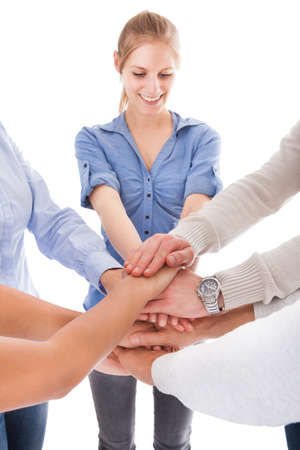 pledge: Group Of People Stacking Hand Together Over White Background Stock Photo