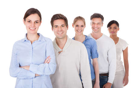 Happy Group Of People Standing In A Row Over White Background Stock Photo