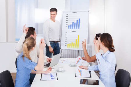 project manager: Business Coworkers Raising Hand For Asking Queries To Team Leader