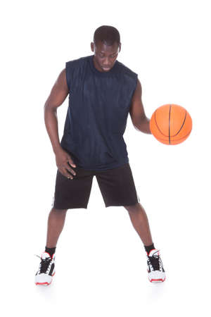 African Young Man With Basketball Isolated Over White Background photo