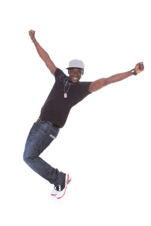 moves: Happy African Young Man Dancing Over White Background