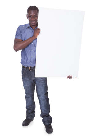 Portrait Of Young African Holding Blank White Board photo