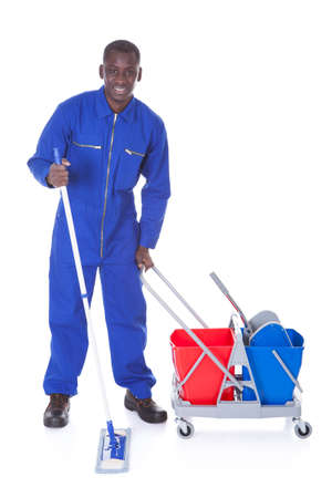 Portrait Of Happy Cleaner Cleaning With Mop Over White Background photo