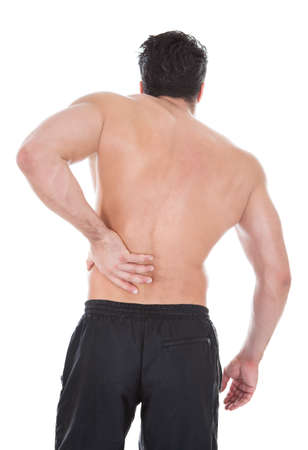 Rear View Of Young Man Suffering From Back Pain photo