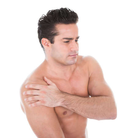 Close-up Of A Muscular Young Man Suffering From Shoulder Pain photo