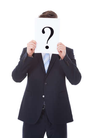 Portrait Of Businessman Holding Question Mark Sign In Front Of Face Stock Photo - 25537871