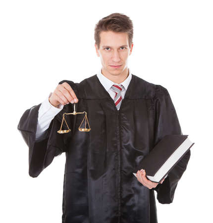 female judge: Young Male Judge Holding Golden Scales And Book Over White Background
