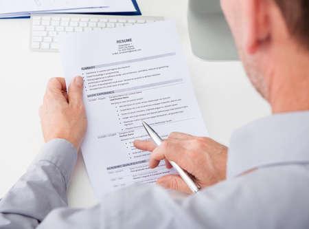 curriculum: Close-up Of Person Hand Holding Curriculum Vitae