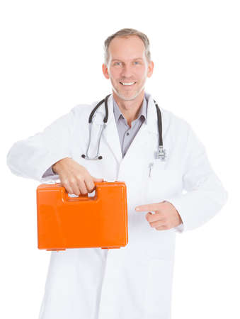 Portrait Of Mature Male Doctor Holding First Aid Box photo