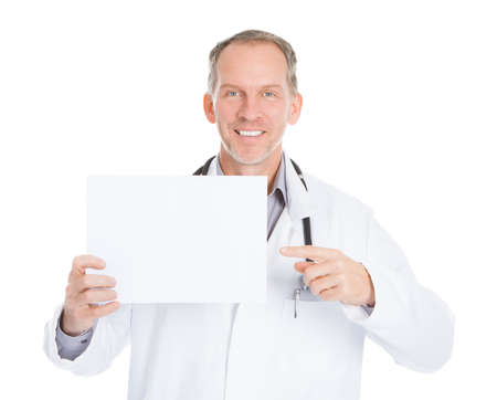 Portrait Of Happy Mature Male Doctor Pointing On Placard photo