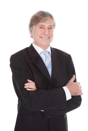 Portrait Of Happy Mature Businessman With Hand In Pocket Over White Background photo