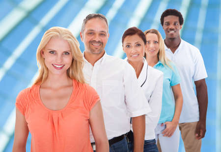 waiting in line: Group Of Multi-racial People Standing In A Row At Office