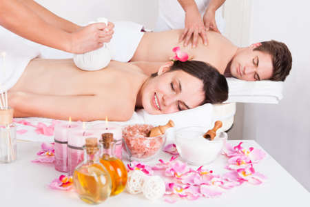 Young Beautiful Man And Woman Getting Massage In Spa photo