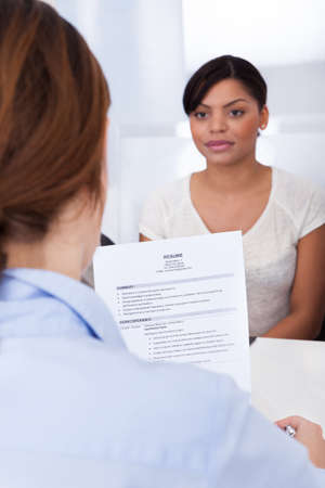 Businesswoman Conducting An Employment Interview With Young Female Applicant Stock Photo