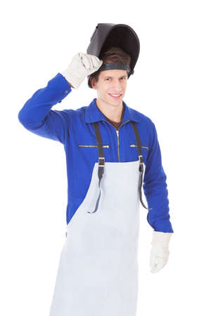 protective workwear: Portrait Of A Male Welder With Protective Workwear Over White Background Stock Photo