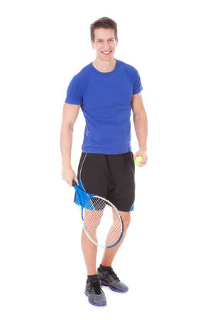 Happy Tennis Player Holding Racquet And Ball Over White Background photo