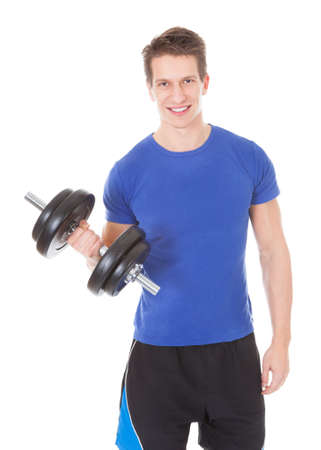 Young Man Exercising With Dumbbells Over White Background photo