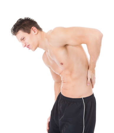 Portrait Of A Young Man Suffering From Back Pain photo
