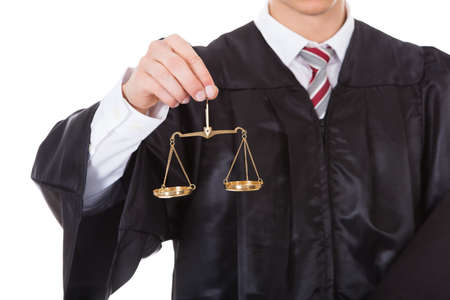 female lawyer: Young Male Judge Holding Golden Scales And Book Over White Background