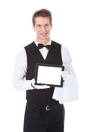 Young Male Waiter Holding Tablet Pc Over White Background