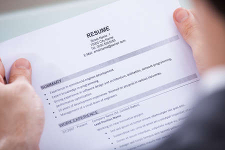 Close-up Of Photo Business Person Holding Resume photo
