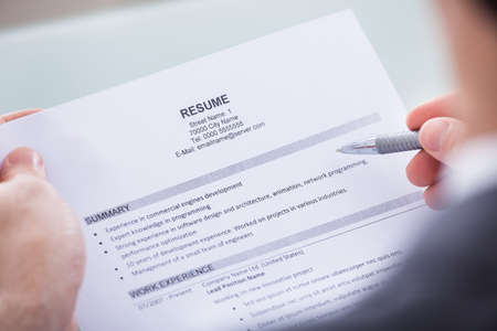 work experience: Close-up Of Photo Business Person Holding Resume