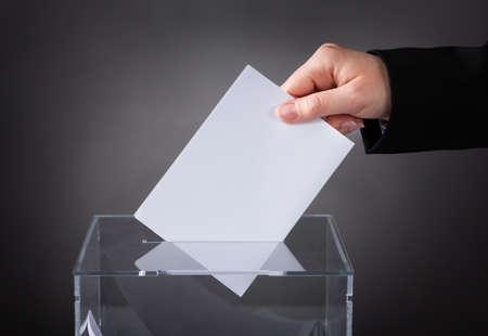 ballot: Close-up Of Hand Putting Ballot In Glass Box