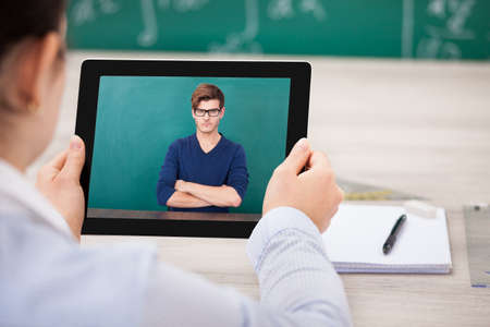 Man And Woman Communicate Through Videochat On Digital Tablet Stock Photo - 26460712