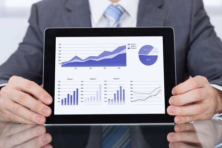 Close-up Of Businessperson Showing Graph On Digital Tablet photo