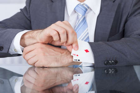 Close-up Of Businessperson Pulling Out A Hidden Ace From The Sleeve photo