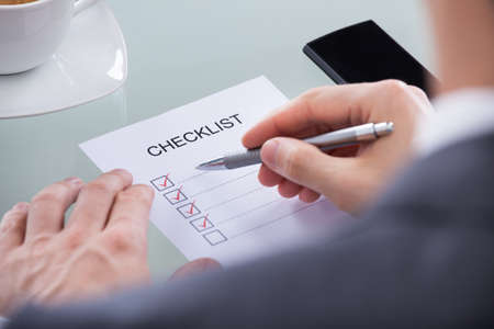Close-up Of Businessperson Hand With Pen Marking A Check Box photo