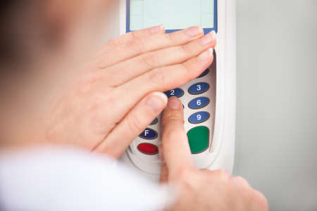 Close-up Of Person Using A Credit Card Reader photo