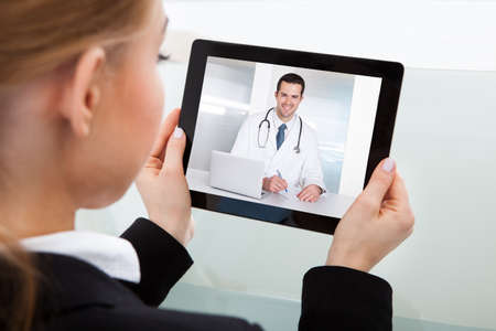 Close-up Of Businesswoman Having A Video Chat With Doctor photo