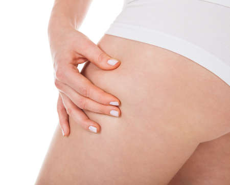 Close-up Of Woman's Buttocks Pinching Excessive Fat photo
