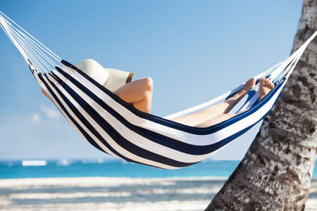 Woman relaxing in hammock at the beach photo